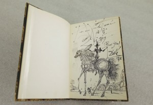 "A 1957 drawing of Don Quixote by Salvador Dali for Walt Disney inside a copy of Shakespeare's ""Macbeth"""