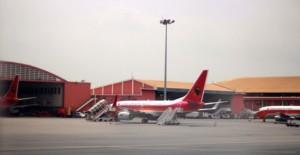 A TAAG plane parked close to a hangar at the Quatro de Fevereiro International Airport, Luanda, Angola