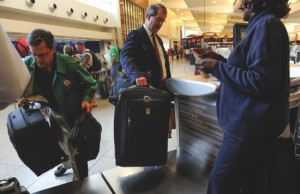 Passengers check-in their luggage at the Delta counter at Hartsfield-Jackson Atlanta International Airport