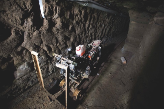 """A motorcycle adapted to a rail sits in the tunnel under the half-built house where according to authorities, drug lord Joaquin """"El Chapo"""" Guzman made his escape from the Altiplano maximum security prison in Almoloya, west of Mexico City"""
