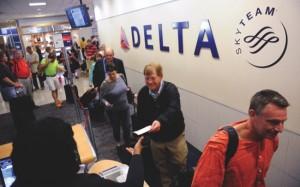 Delta Air Lines passengers board their flight at Hartsfield-Jackson Atlanta International Airport in Atlanta