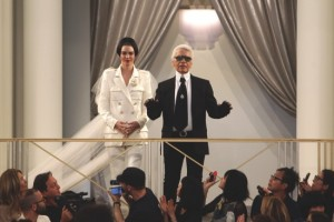 Fashion designer Karl Lagarfeld, right, aknowledges applause with model Kendall Jenner