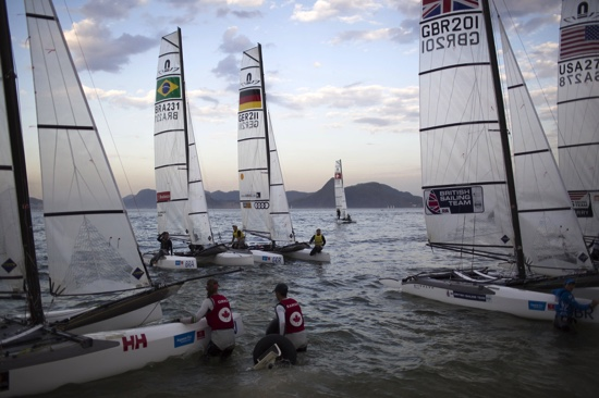 Athletes from the Nacra 17 Mixed Multihull class return to Flamengo beach after competing in a sailing test event for the Rio 2016 Olympic Games in Guanabara Bay, Rio de Janeiro, Brazil