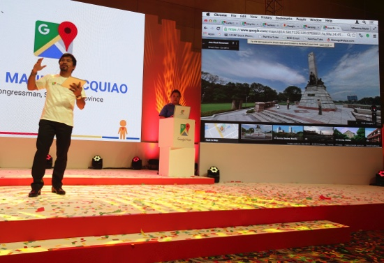 Filipino boxing icon Manny Pacquiao, left, gestures as he talks beside a picture of Manila's Jose Rizal monument during a speech in support of Philippine tourism in suburban Pasay, south of Manila, Philippines on Wednesday, Sept. 16, 2015. Pacquiao and tourism officials say images of the Philippine capital and the country's main tourist spots on Google's Street View could help attract more visitors to the country. (AP Photo/Aaron Favila)