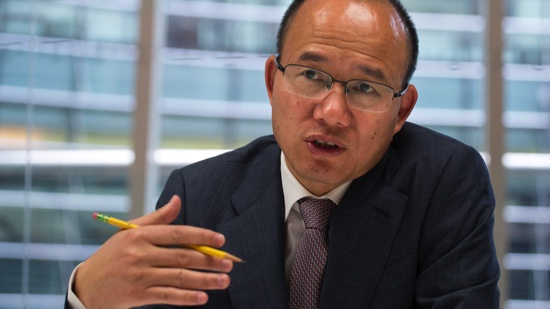 Guo Guangchang, chairman and chief executive officer of Fosun Group, speaks during an interview in New York, U.S., on Thursday, April 23, 2015