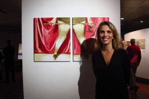 Sofia Bobone poses next to one of her paintings