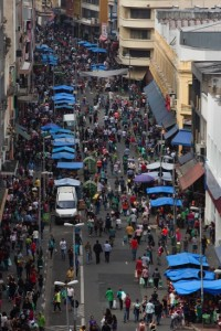 People walk at a shopping district in Sao Paulo, Brazil