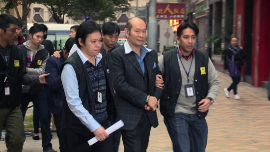 Alan Ho at the moment of his arrest