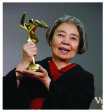 Japanese actress Kirin Kiki poses after winning the Lifetime Achievement award
