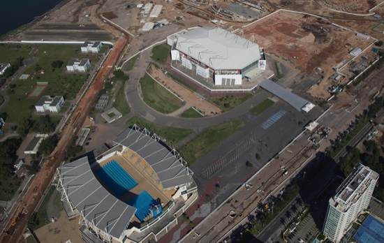 This June 27, 2014 file photo, shows the Olympic Arena (top) and the Maria Lenk Aquatics Center under construction in Rio de Janeiro