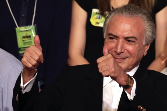 Michel Temer flashes two thumbs up during the Brazilian Democratic Movement Party national convention in Brasilia