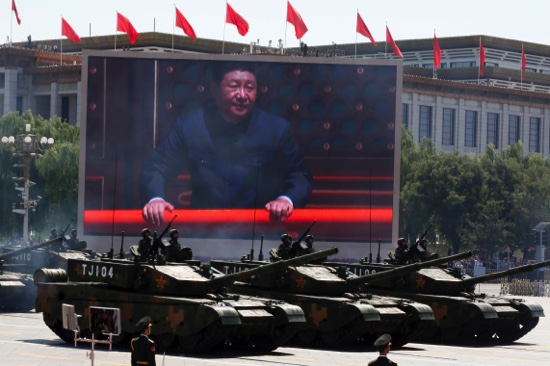 Chinese President Xi Jinping is displayed on a screen as Type 99A2 Chinese battle tanks take part in a parade commemorating the 70th anniversary of Japan's surrender during World War II held in front of Tiananmen Gate