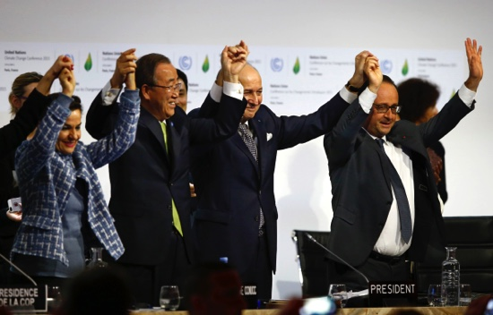 French President Francois Hollande (right), French Foreign Minister and president of the COP21 Laurent Fabius (second right), United Nations climate chief Christiana Figueres (left), and United Nations Secretary General Ban Ki-moon hold their hands up in celebration after the final conference at the COP21, the United Nations conference on climate change