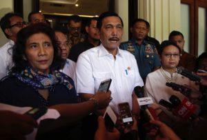 Coordinating Minister for Politics, Legal and Security Affairs Luhut Pandjaitan (center)