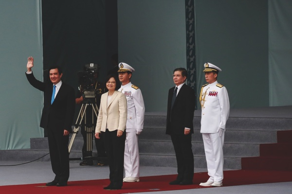 Ma Ying-jeou, outgoing Taiwan's president (left), waves as Tsai Ing-wen, incoming Taiwan's president (second left), looks on during Tsai's inauguration ceremony