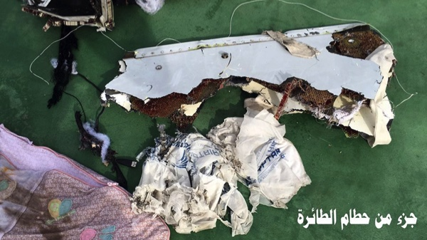 "This picture posted Saturday, May 21, 2016, on the official Facebook page of the Egyptian Armed Forces spokesman shows part of the wreckage from EgyptAir flight 804. Search crews found floating human remains, luggage and seats from the doomed EgyptAir jetliner Friday but face a potentially more complex task in locating bigger pieces of wreckage and the black boxes vital to determining why the plane plunged into the Mediterranean. Arabic reads: "" Part of plane wreckage"".  (Egyptian Armed Forces Facebook via AP)"
