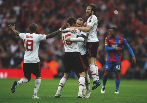 United players celebrate at the end of the English FA Cup final