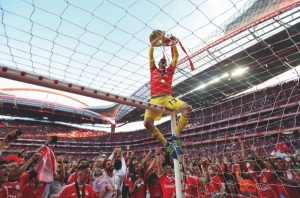 Benfica goalkeeper Paulo Lopes shows the trophy