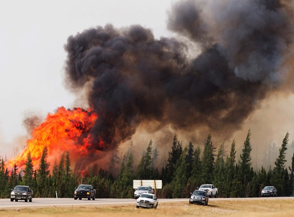 A wildfire burns south of Fort McMurray, Alberta