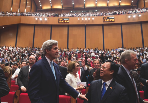 Secretary of State John Kerry stands in the front of the auditorium after attending U.S. President Barack Obama's speech at the National Convention Center in Hanoi