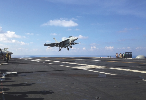 In this Friday, April 15, 2016 file photo, an FA-18 jet fighter lands on the USS John C. Stennis aircraft carrier in the South China Sea while U.S. Defense Secretary Ash Carter visited the aircraft carrier during a trip to the region