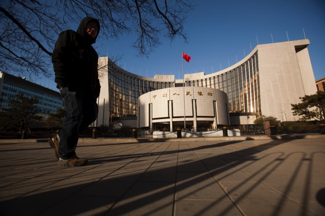 A pedestrian walks past the People's Bank of China in Bejing