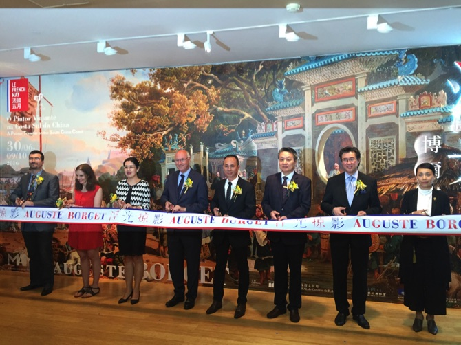 Distinguished guests cut the ribbon marking the opening of the exhibition