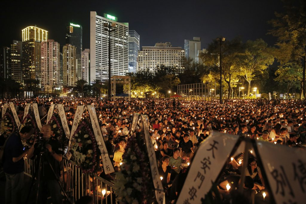 Tens of thousands of people attend a candlelight vigil at Victoria Park in Hong Kong, today (Saturday, June 4) to commemorate victims of the 1989 military crackdown in Beijing. China's bloody crackdown on the Tiananmen Square pro-democracy protests was a pivotal moment in the country's political development. Despite the Communist Party's efforts to erase memories of the event, every year its anniversary triggers heightened security and surveillance on the mainland, along with furtive commemorations by a handful of activists. (AP Photo/Kin Cheung)