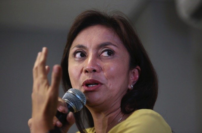 In this May 10, 2016 file photo, then Philippine vice presidential candidate Leni Robredo gestures during a press conference in suburban Quezon city, north of Manila