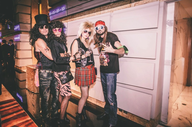 "Guest attendees dressed as member of rock band, ""Guns 'N' Roses"""