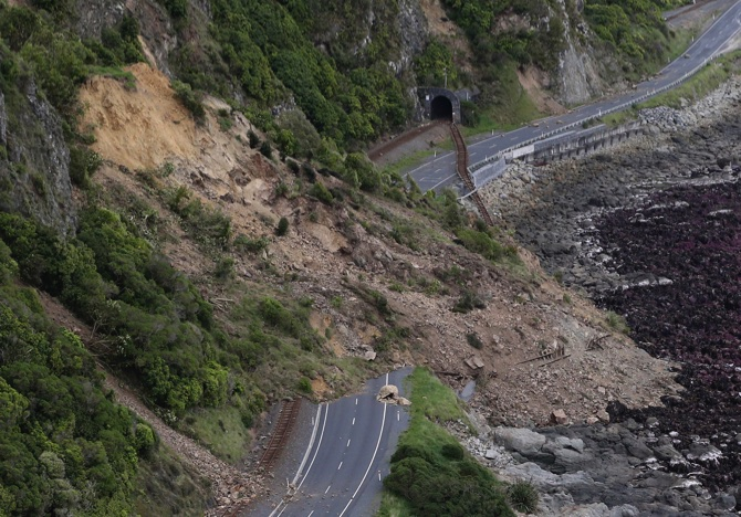 A landslide blocks State Highway One and the main trunk railway line north of Kaikoura